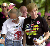 Washington, D.C. - July 4, 2006 -- Anti-war activists Michael Berg, left, and Cindy Sheehan, right, join protestors  in Lafayette Park across from the White House during day 1 of a hunger strike against Operation Iraqi Freedom in Washington, D.C. on July 4, 2006..Credit: Ron Sachs / CNP
