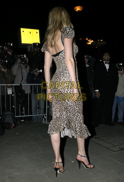 PENNY LANCASTER.At La Dolce Vita Ball in association with UNICEF,.Old Billingsgate, London, December 13th 2004..full length leopard animal print dress back behing rear.Ref: AH.www.capitalpictures.com.sales@capitalpictures.com.©Capital Pictures.