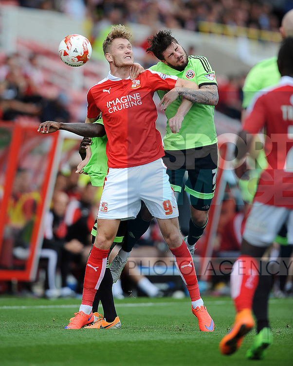 Kieron Freeman of Sheffield United Michael Smith of Swindon Town is challenged by<br /> - English League One - Swindon Town vs Sheffield Utd - County Ground Stadium - Swindon - England - 29th August 2015 <br /> --------------------