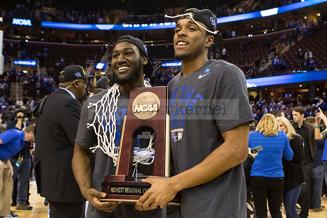 Guard Dominique Hawkins and guard EJ Floreal of the Kentucky Wildcats pose for a photo following UK's win in the Elite 8 of the 2015 NCAA Men's Basketball Tournament against the Notre Dame Fighting Irish at Quickens Loans Arena on Saturday, March 28, 2015 in Cleveland, OH. Kentucky defeated Notre Dame 68-66 to advance to the Final Four in Indianapolis. Photo by Michael Reaves | Staff.