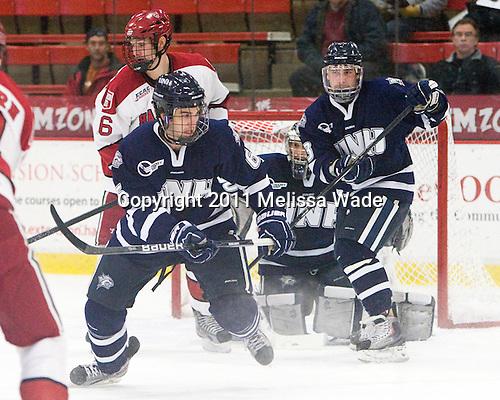 Alex Fallstrom (Harvard - 16), Trevor van Riemsdyk (UNH - 6), Austin Block (UNH - 3) - The Harvard University Crimson defeated the University of New Hampshire Wildcats 7-6 on Tuesday, November 22, 2011, at Bright Hockey Center in Cambridge, Massachusetts.