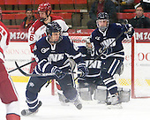 Alex Fallstrom (Harvard - 16), Trevor van Riemsdyk (UNH - 6), Austin Block (UNH - 3) - The Harvard University Crimson defeated the University of New Hampshire Wildcats 7-6 on Tuesday, November 22, 2011, at Bright Hockey Center in Cambridge, Massachusetts.