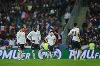 Jermaine Jones, Maurice Edu, Carlos Bocanegra and Clint Dempsey of team USA react during the friendly match France against USA at the Stade de France in Paris, France on November 11th, 2011.