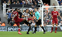 Liverpool's Georginio Wijnaldum vies for possession with Newcastle United's Isaac Hayden<br /> <br /> Photographer Rich Linley/CameraSport<br /> <br /> The Premier League -  Newcastle United v Liverpool - Sunday 1st October 2017 - St James' Park - Newcastle<br /> <br /> World Copyright &copy; 2017 CameraSport. All rights reserved. 43 Linden Ave. Countesthorpe. Leicester. England. LE8 5PG - Tel: +44 (0) 116 277 4147 - admin@camerasport.com - www.camerasport.com