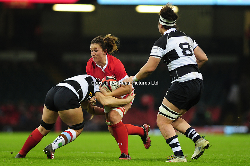 Siwan Lillicrap of Wales is tackled by Anna Caplice of Barbarians during the International friendly match between Wales and Barbarians at the Principality Stadium in Cardiff, Wales, UK. Saturday 30 November 2019