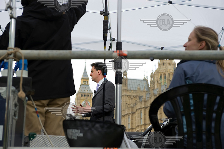 Labour MP Ed Miliband is interviewed by Sky News on College Green in front of the Houses of Parliament in Westminster, London on the day after the general election took place.