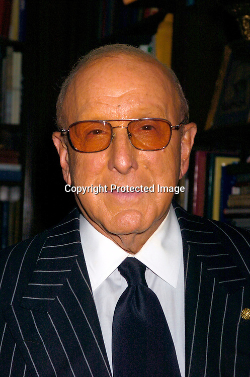"Clive Davis ..at the Book Party for Arnold Scaasi's new book ""Women I Have Dressed (and Undressed!) at Le Cirque on ..September 23, 2004. ..Photo by Robin Platzer, Twin Images"
