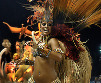 A dancer from Porto da Pedra samba school performs at the Sambadrome during the samba school parade in Rio de Janeiro, Brazil, February 23, 2009.