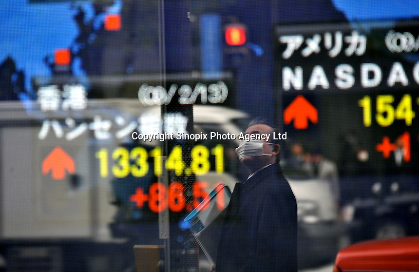 A screen advertises the latest stock exchange figures from around the world, Tokyo, Japan. Japan has seen 12.7 per cent drop in GDP in the last 12 months the steepest drop since 1974. ?This is the biggest economic crisis since the war,? said Kaoru Yosano, minister for economic and fiscal policy. Japan has been hit extremely hard by the economic crisis and hundreds of thousands have lost their jobs in the last two months and the TOPIX has lost Aaround 40% since last year..