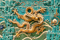 At the north end of Beihai Park in Beijing, the massive Nine Dragon Wall stands as a testament to a time when superstition determined the course of daily life in the heart of one of the world's oldest civilizations. The center of the 250-year-old wall is dominated by a large dragon flanged and intertwined with eight other giant beasts in a tile mosaic representing the nine legendary sons of the Chinese dragon..