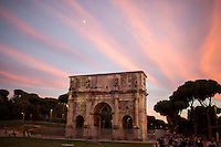 The sun sets behind the Arch of Constantine on Tuesday, Sept. 22, 2015, in Rome, Italy. (Photo by James Brosher)