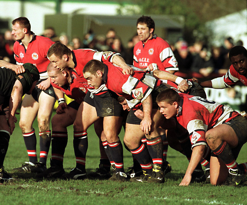 Photo. Richard Lane. .London Irish v Gloucester.7/2/99..Gloucester fron row (lt to rt) Adey Powles, Neil McCarthy and Trevor Woodman, with Dave Simms (second row), Ed Pearce (flank) and Steve Ojomoh (No. 8).