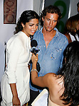 Camila Alves and Actor Matthew McConaughey arrive at the launch of Camila Alves' Handbag Collection MUXO at Kitson Studio on August 7, 2008 in Los Angeles, California.