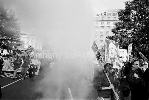 Washington DC.USA<br /> October 25, 2003<br /> <br /> Anti-War - Iraqi War demonstration in Washington DC attended by 50,000 people and a number of small groups of Pro-War - Bush counter demonstrators.