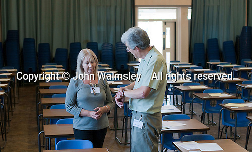 Invigilators ready for a GCSE Maths exam, state secondary school.