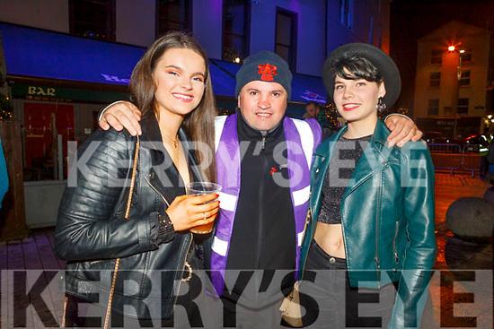 Rachel Godley (Ballymac), John Counihan (Abbeydorney) and Deirdre Vanderkrogt (Macroom) enjoying the Freshers Fest in the Square on Tuesday night..