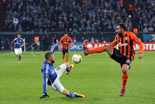 25.02.2016. Gelsenkirchen, Germany. Europa League Round of 32 Second Leg soccer match between Schalke 04 and FC Shakhtar Donetsk in the Veltins Arena in Gelsenkirchen, Germany. Sidney Sam (FC Schalke 04) and Ismaily (Donezk)