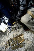Roma, 12 Gennaio 2017<br /> L'artista tedesco Gunter Denming installa le pietre d'inciampo in Via dell'Acqua Bullicante a Tor Pignattara davanti il luogo di lavoro dei partigiani Renato Cantalamessa, Egidio Checchi, Orazio Corsi, Mario Passarella e Alessandro Portieri, arrestati dalla Gestapo nazista il 14 marzo, detenuti a Via Tasso e assassinati alle Fosse Ardeatine. <br /> <br /> Rome, January 12, 2017<br /> The German artist Gunter Denming installs the stumbling blocks in Via Acqua Bullicante in Torpignattara in front of the place of work of partisan Renato Cantalamessa , Egidio Checchi,Orazio Corsi , Mario Passarella and Alessandro Portieri, arrested by the Nazi Gestapo on March 14 , held in Via Tasso and killed at the Fosse Ardeatine.