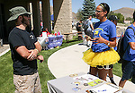 Clinton Sisk, left, talks with Shawna Vernon during a student BBQ and club fair at Western Nevada College in Carson City, Nev., on Thursday, Sept. 1, 2016. <br />Photo by Cathleen Allison