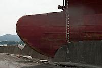 Daytime landscape view of the damaged Asia Symphony ship on land at the Kamaishi Port following the 311 Tohoku Tsunami in Kamaishi, Japan  © LAN