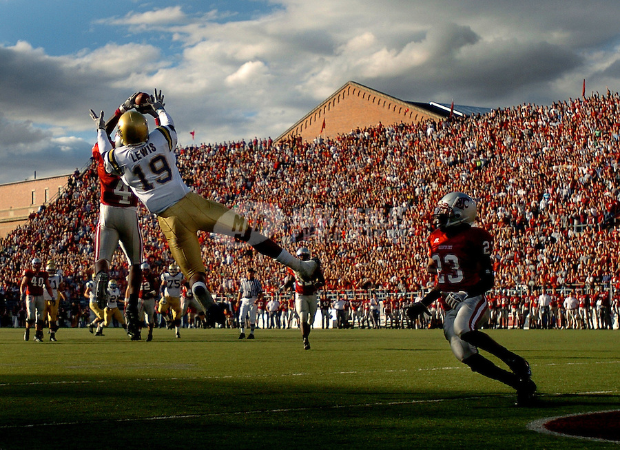Oct 15, 2005; Pullman, Wash, USA; Washington State Cougars cornerback #4 Omowale Dada intercepts the ball intended for UCLA Bruins receiver Mercedes Lewis (19) in the first quarter at Martin Stadium. Mandatory Credit: Photo By Mark J. Rebilas