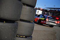 Aug 30, 2008; Fontana, CA, USA; NASCAR Sprint Cup Series driver Juan Pablo Montoya drives past stacks of goodyear tires during practice for the Pepsi 500 at Auto Club Speedway. Mandatory Credit: Mark J. Rebilas-