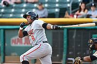 Tony Abreu (6) of the Fresno Grizzlies at bat against the Salt Lake Bees at Smith's Ballpark on April 9, 2014 in Salt Lake City, Utah.  (Stephen Smith/Four Seam Images)