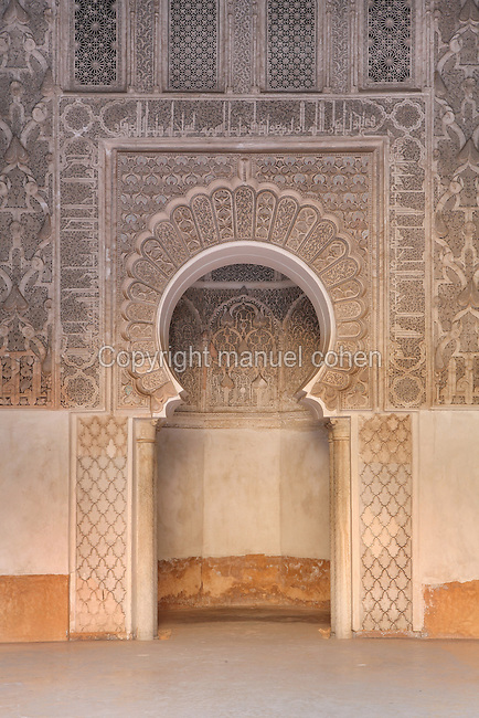 Mirhab of the Ben Youssef Madrasa, Medina, Marrakech, Morocco. The Madrasa is an Islamic theological college founded in the 14th century and rebuilt by the Saadians in the 1560s. It is named after the Almoravid Sultan Ali ibn Yusuf, who reigned 1106-42. The mihrab is a niche indicating the direction of the Kaaba in Mecca for prayer and is intricately carved. Picture by Manuel Cohen