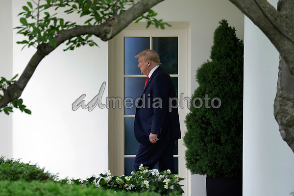 United States President Donald J. Trump walks out from the Oval Office of the White House in Washington, DC before his departure to Detroit on May 21, 2020. Trump is going to participate in a listening session with African-American leaders and tour Ford Rawsonville Components Plant in Ypsilanti, Michigan. <br /> Credit: Yuri Gripas / Pool via CNP/AdMedia