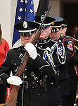 An honor guard of Belleville firefighters and police officers present the colors at the start of the ceremony. The city of Belleville held their 21st annual Veterans Day ceremony inside Belleville City Hall on Thursday November 11, 2019. It was moved inside due to the winter weather.<br /> Photo by Tim Vizer