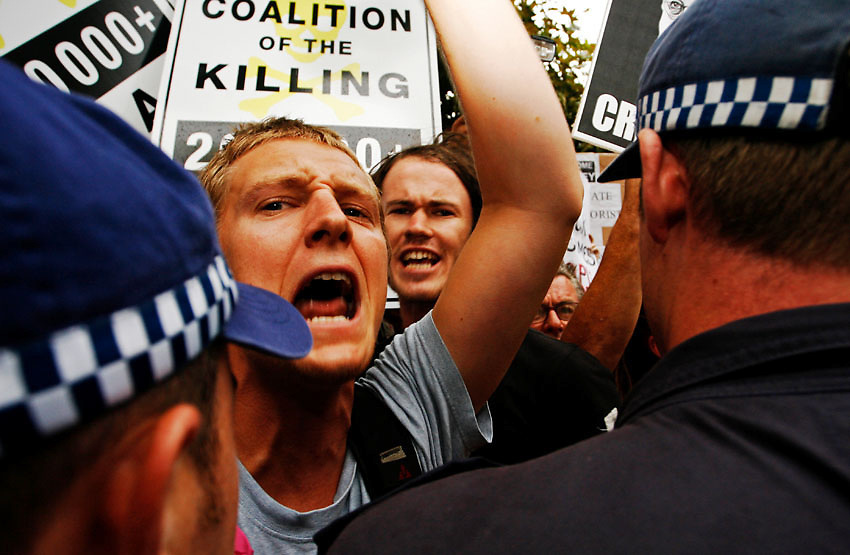 A protester chants in the midst of an anti-Iraq War protest during the visit of U.S. Vice President Dick Cheney in Sydney, February 22 2007. According to ABC News seven protesters were arrested during brief clashes betweenpolice and demonstrators at Sydney's Town Hall. Photo: Ed Giles.