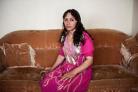 Mina_a maid_sits on the sofa of the foreign journalist's place /Felix Features
