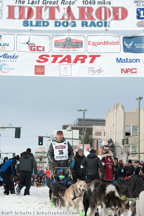 Mats Pettersson and team leave the ceremonial start line with an Iditarider at 4th Avenue and D Street in downtown Anchorage, Alaska on Saturday, March 5th during the 2016 Iditarod race. Photo by Joshua Borough/SchultzPhoto.com