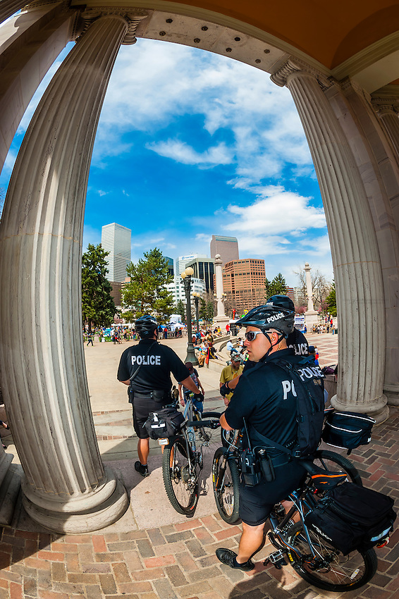 Denver Police on bicycle patroling the 420 Cannabis Culture Music Festival, Civic Center Park, Downtown Denver, Colorado USA. This was the first 4/20 celebration since recreational pot became legal in Colorado January 1, 2014. A crowd of up to 80,000 people attended the event.