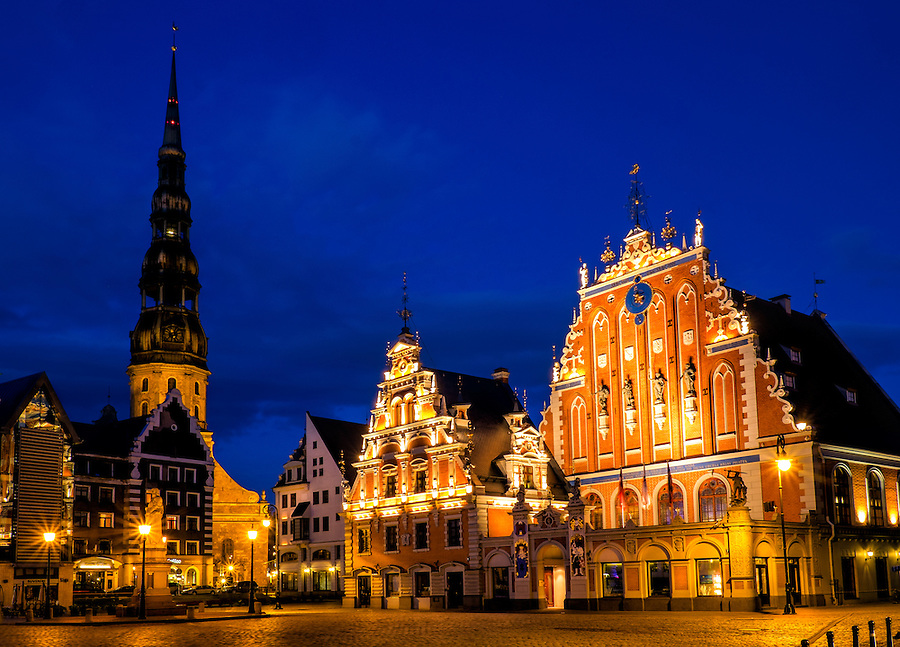 "RIGA, LATVIA - CIRCA MAY 2014: Night view of the Town Square Hall  with ""The House of Blackheads"" and St. Peter's Church in old town Riga at night."