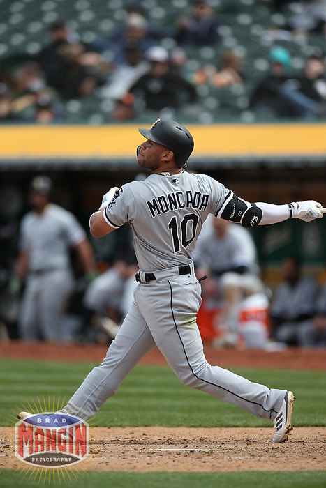 OAKLAND, CA - APRIL 18:  Yoan Moncada #10 of the Chicago White Sox bats against the Oakland Athletics during the game at the Oakland Coliseum on Wednesday, April 18, 2018 in Oakland, California. (Photo by Brad Mangin)