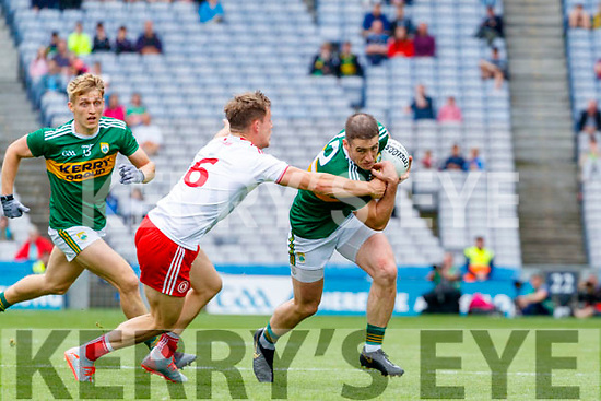 Stephen O'Brien, Kerry in action against Kieran McGeary, Tyrone during the All Ireland Senior Football Semi Final between Kerry and Tyrone at Croke Park, Dublin on Sunday.