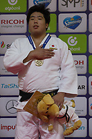 Gold medalist Kokoro Kageura of Japan celebrates his victory during an awards ceremony after the Men +100 kg category at the Judo Grand Prix Budapest 2018 international judo tournament held in Budapest, Hungary on Aug. 12, 2018. ATTILA VOLGYI