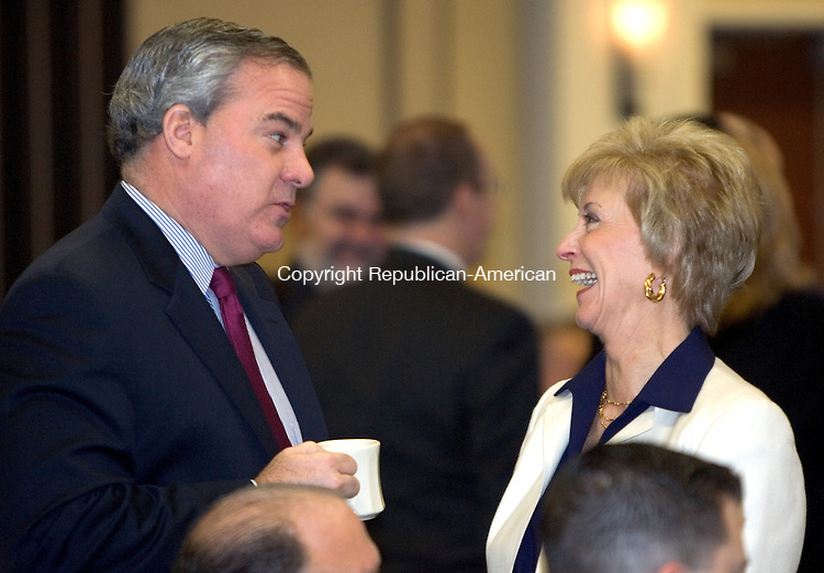 WATERBURY, CT. 27 January 2010-012710SV14--From left, Former Governor John Rowland, Waterbury&rsquo;s Economic Development Director, and Linda McMahon candidate for senate talk at the Legislative Breakfast sponsored by The Waterbury Regional Chamber Public Policy Committee held at the Courtyard by Marriott in Waterbury Wednesday.<br /> Steven Valenti Republican-American