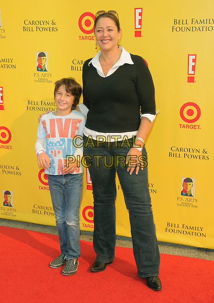 CAMRYN MANHEIM & son MILO.at The 2008 P.S. Arts' Express Yourself sponsored by Target held at Barker Hangar in Santa Monica, California, USA,  November 16th 2008.                                                                     .full length black  Jumper sweater jeans family son child kid mother white shirt .CAP/DVS.©Debbie VanStory/Capital Pictures