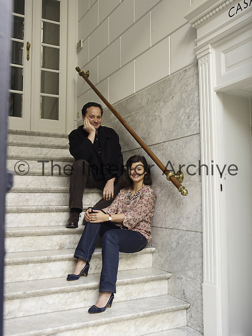 Anne-Marie Midy and her husband Jorge Almada on the steps of their Brussels townhouse