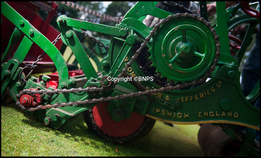 BNPS.co.uk (01202 558833)<br /> Pic: PhilYeomans/BNPS.co.uk<br /> <br /> Lawnmowing aristocracy...<br /> <br /> Heath robinson style belts, cogs and chains.<br /> <br /> The worlds first powered mower has taken to the grass once more after an exhaustive restoration by lawnmower nut Andrew Hall from Somerset.<br /> <br /> Forerunner of all the machines that have graced British lawns on sunday afternoons through the decades since, This 1902 Ransome 3hp is a historic survivor from the Edwardian age when chauffers were given the task of grooming their masters lawns and the new fangled machines cost as much as a house.