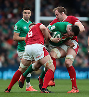 8th February 2020; Aviva Stadium, Dublin, Leinster, Ireland; International Six Nations Rugby, Ireland versus Wales; James Ryan (Ireland) is tackled by Aaron Wainwright (Wales) and Alun Wyn Jones (Captain Wales)