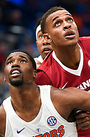 NWA Democrat-Gazette/CHARLIE KAIJO Arkansas Razorbacks forward Daniel Gafford (10) positions for control of a free throw as Florida Gators forward Kevarrius Hayes (13) and guard KeVaughn Allen (5) cover during the Southeastern Conference Men's Basketball Tournament quarterfinals, Friday, March 9, 2018 at Scottrade Center in St. Louis, Mo.