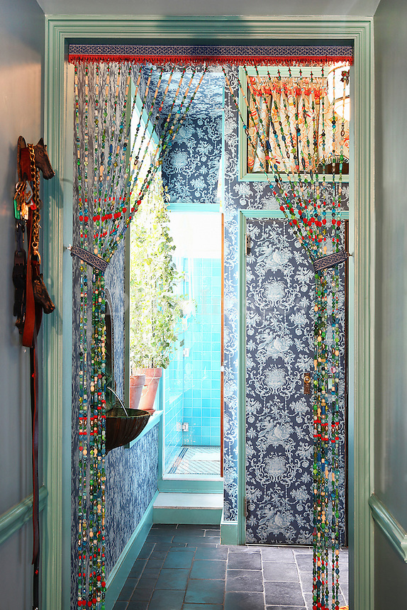 colorful hallway..A 3000 sq. ft. loft in the Tribeca area of Manhattan owned by photographer and sculptor, Meghan Boody of Looking Glass Labs.   The loft was completely gutted and transformed from a hippie style dwelling into a dream, Feng Shui all immersive environment by Randy Polumbo from Plant Construction.