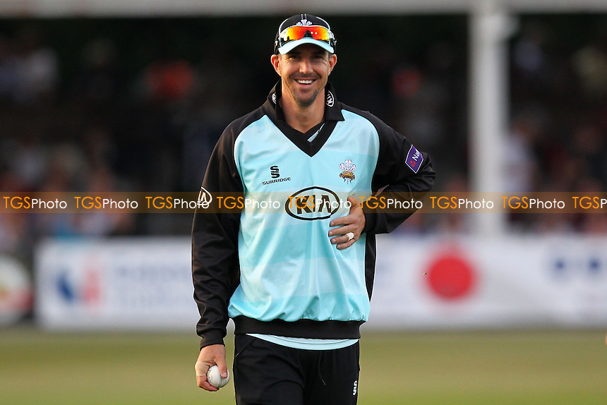 Kevin Pietersen of Surrey smiles as he holds his side where he was hit by a ball earlier in the evening - Essex Eagles vs Surrey Lions - NatWest T20 Blast Cricket at the Essex County Ground, Chelmsford - 04/07/14 - MANDATORY CREDIT: Gavin Ellis/TGSPHOTO - Self billing applies where appropriate - 0845 094 6026 - contact@tgsphoto.co.uk - NO UNPAID USE
