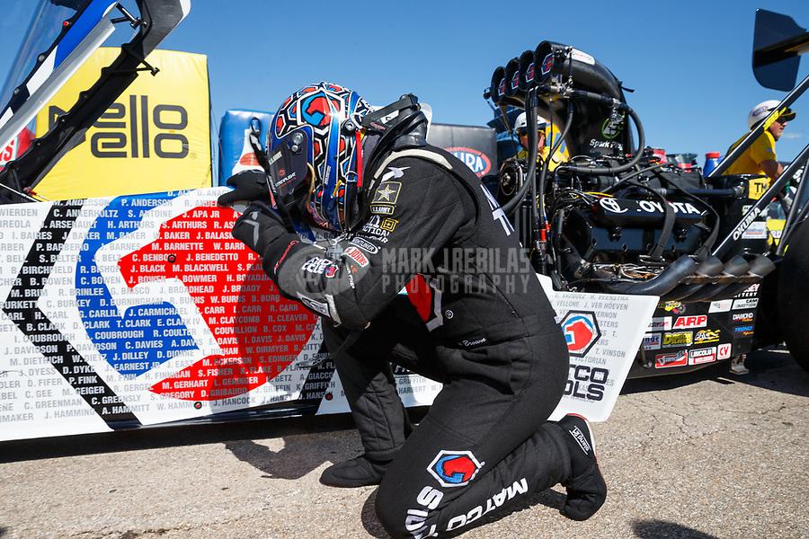 May 21, 2017; Topeka, KS, USA; NHRA top fuel driver Antron Brown celebrates after winning the Heartland Nationals at Heartland Park Topeka. Mandatory Credit: Mark J. Rebilas-USA TODAY Sports