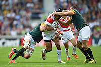 Male Sa'u of Japan is double-tackled. Rugby World Cup Pool B match between South Africa and Japan on September 19, 2015 at the Brighton Community Stadium in Brighton, England. Photo by: Patrick Khachfe / Onside Images