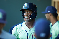 Seuly Matias (25) of the Wilmington Blue Rocks is all smiles after hitting a solo home run in the first inning against the Winston-Salem Dash at BB&T Ballpark on April 15, 2019 in Winston-Salem, North Carolina. The Dash defeated the Blue Rocks 9-8. (Brian Westerholt/Four Seam Images)