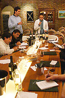 The winemaker and oenologist and a group of wine tasters tasting in the cellar Bodega Castillo Viejo Winery, Las Piedras, Canelones, Uruguay, South America